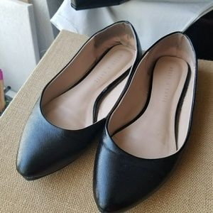 Black pointy flat shoes.